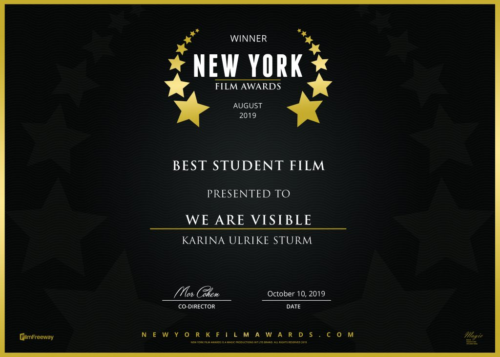 Winner Certificate. White letters on black background. Winner, New York Film Awards, August 2019, Best Student Film, Presented to: We Are Visible, Karina Ulrike Sturm